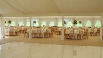 Marquee with dance floor, tables and chairs in Essex